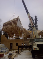 Thumbnail image of lifting roof section. All roof sections were put up in one day