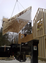 Thumbnail image of lifting other half of roof section. All roof sections were put up in one day