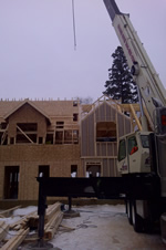 Thumbnail image of lifted roof sections. All roof sections were put up in one day